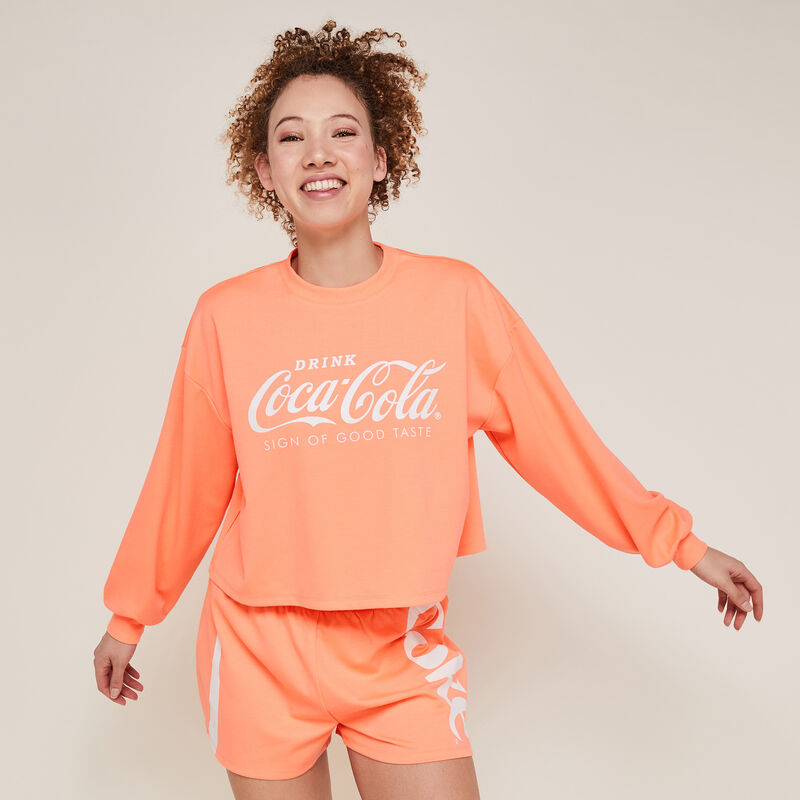 Short de muletón de coca-cola color coral fluorescente;