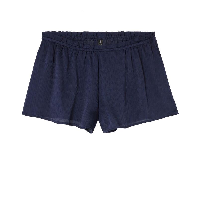 Shorts fluidos con volante - azul;